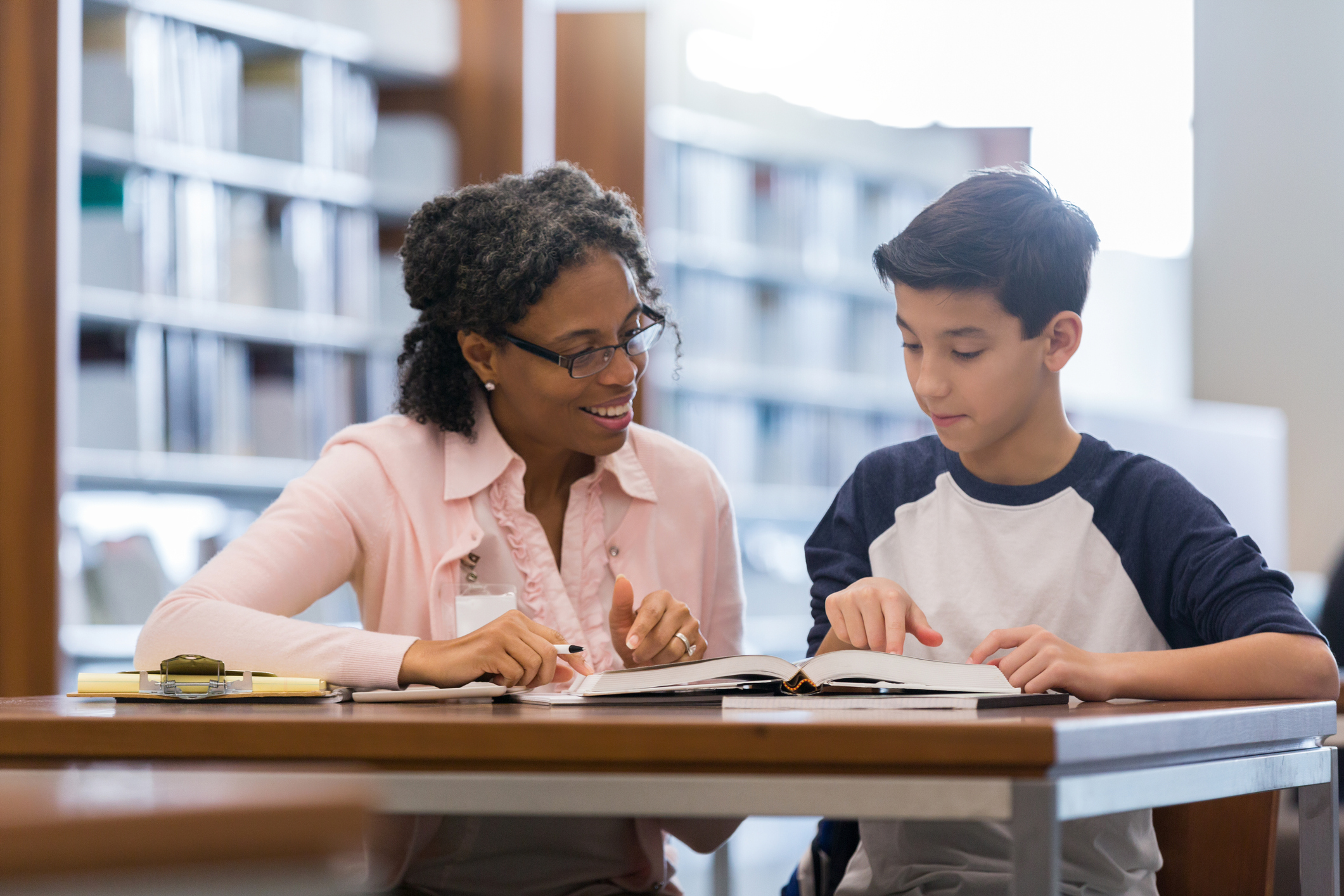 Tutor working with middle school student